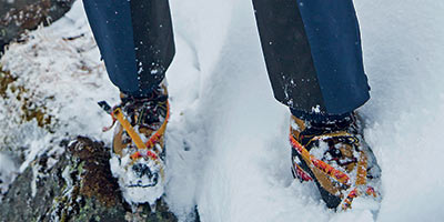 mountaineering boots covered in snow