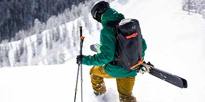 Person backcountry skiing wearing arcteryx gear