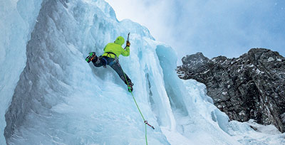 Man Ice Climbing with Edelrid Ice Axes
