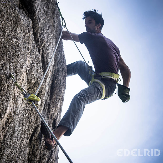 man climbing rock with edelrid equipment
