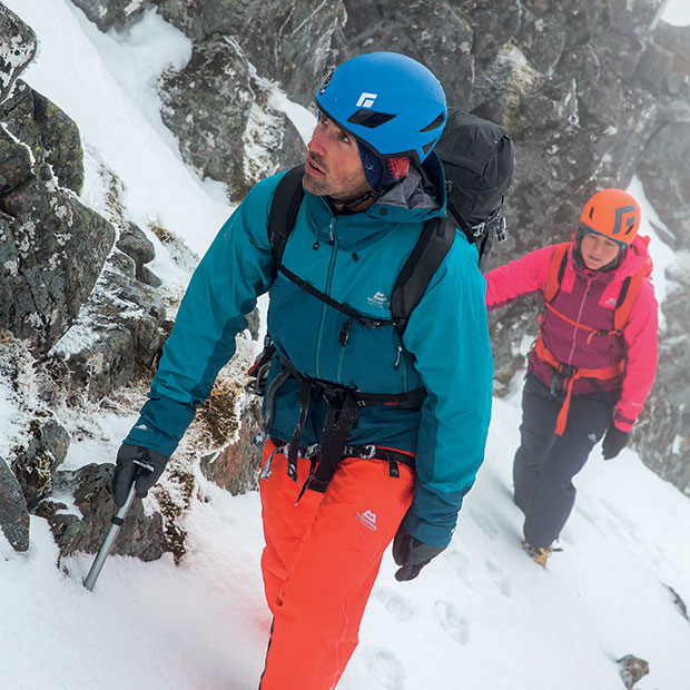 mountaineers going uphill in wintry conditions wearing mountain equipment clothing