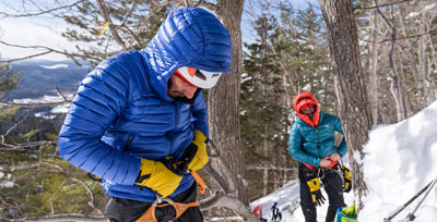 Men alpine climbing in  Rab clothing