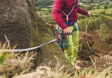 A man pulling a climbing rope