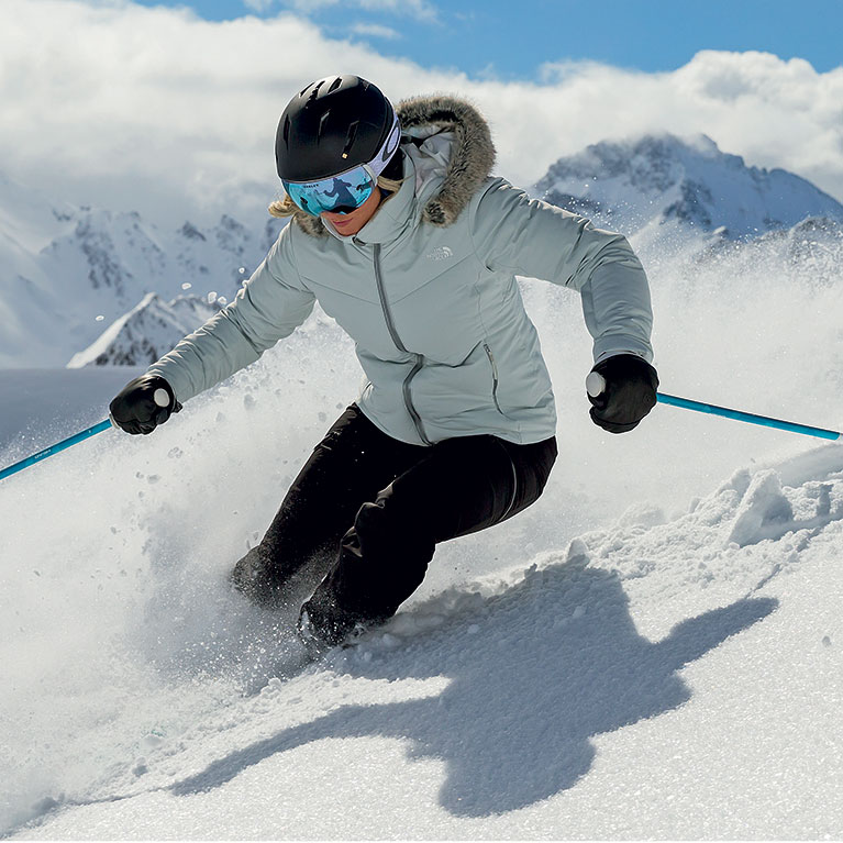 A woman skiing in deep snow