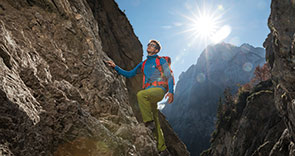 a man stood on a rocky crag