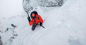 male ice climbing