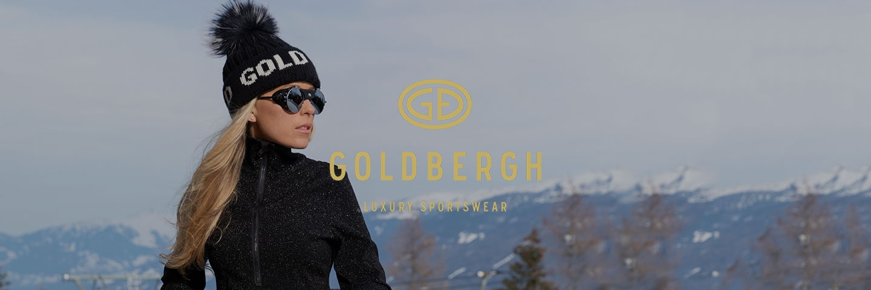 woman wearing Goldbergh hat with snowy scene in background