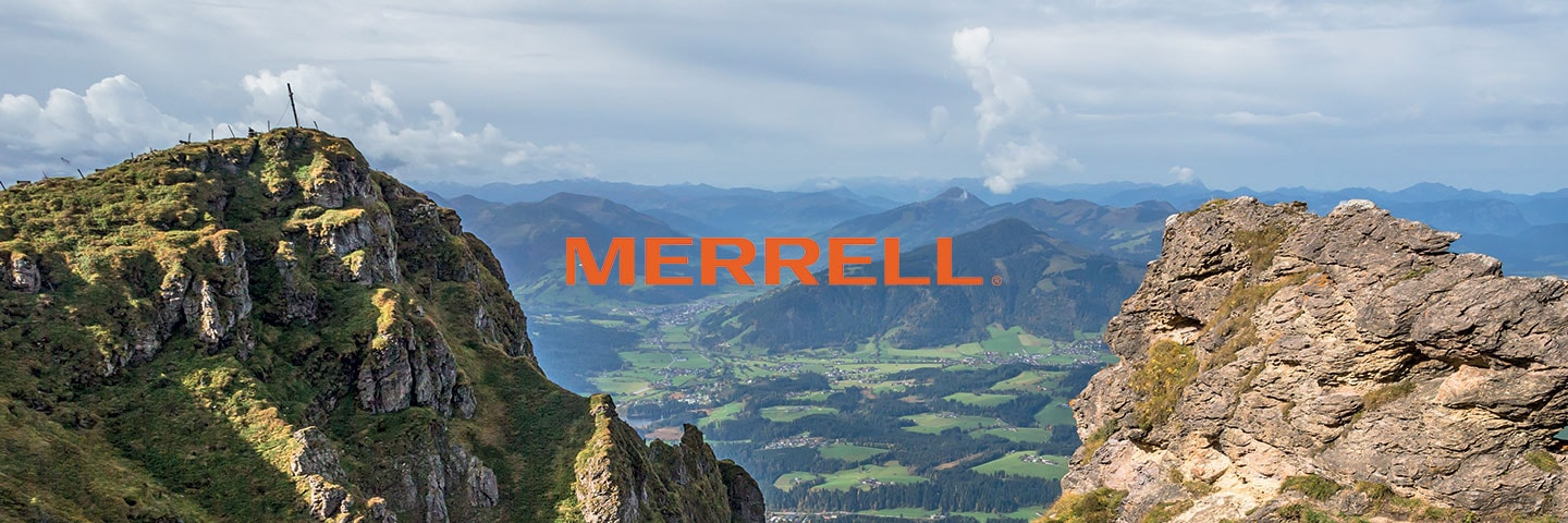 Merrell logo with scenic green background
