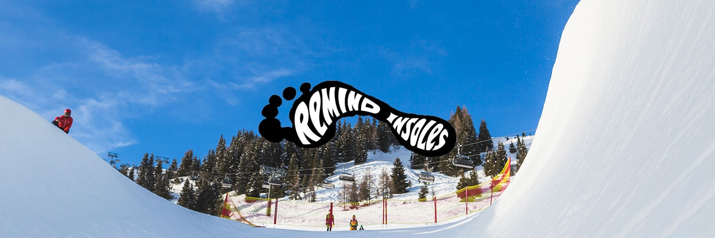 Remind Insoles logo with groomed snowsports slope in the background