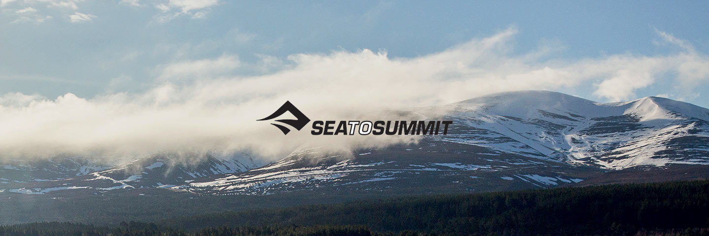 Sea To Summit logo with sea and mountains in background