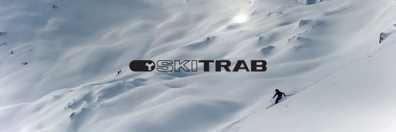 SkiTrab logo with snowy background