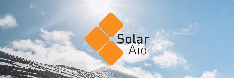SolarAid logo with misty blue sky background