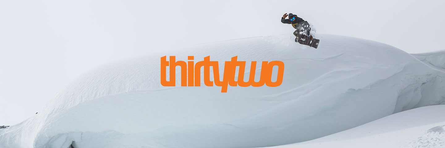 ThirtyTwo logo with snowboarder making a jump in background