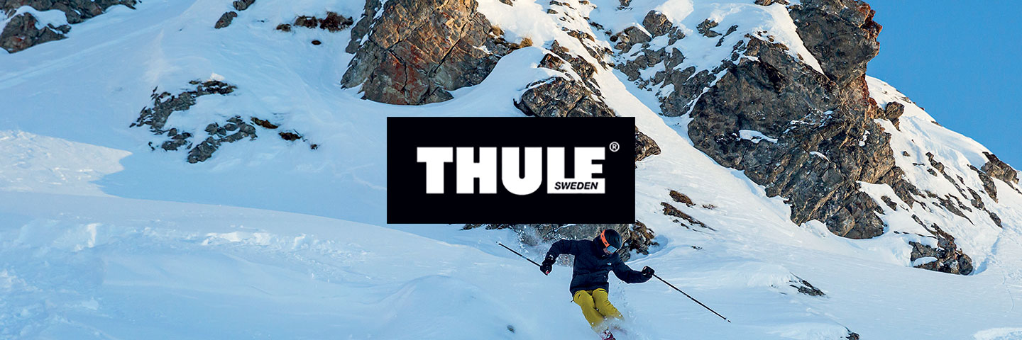 Thule  logo with snowy mountain crag behind