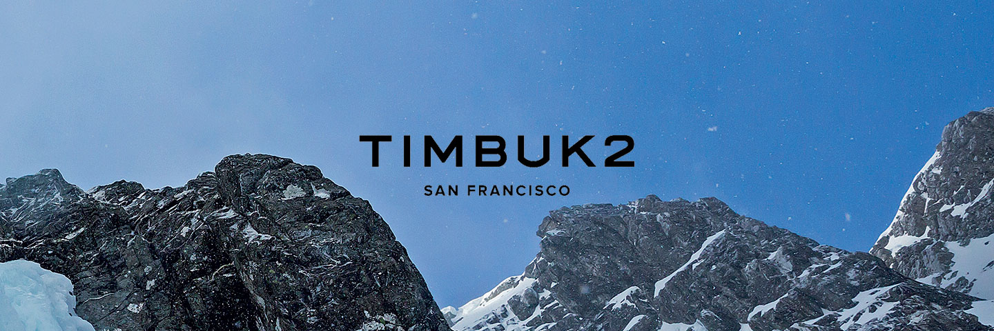 Timbuk2 logo with mountain peaks in background