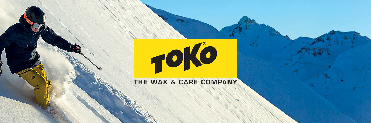 Toko logo with skier heading downhill