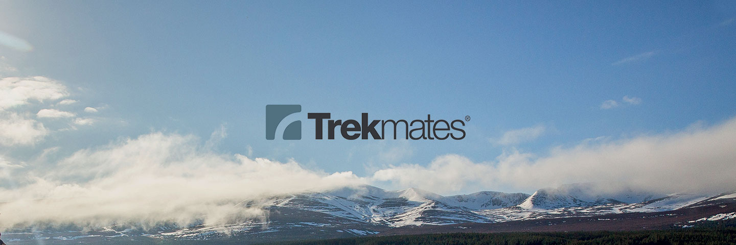 Trekmates logo with cloudy mountain peaks in background