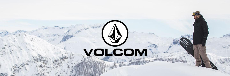 Volcom logo snowy mountain scene with snowboarder