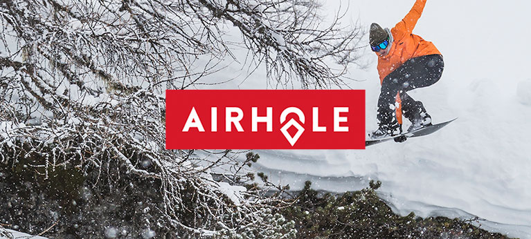 Airhole logo with snowboarder and tree in background
