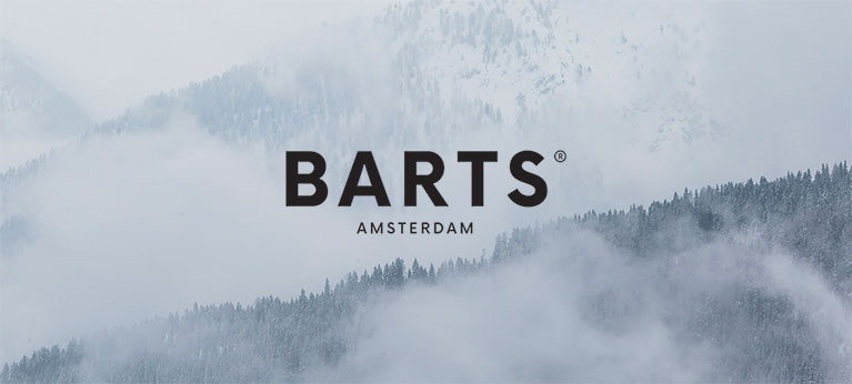 Barts logo with misty forest background