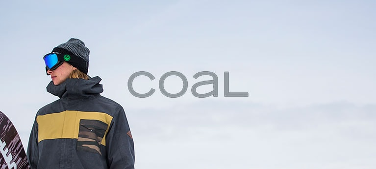 Coal logo with snowboarder standing to the side