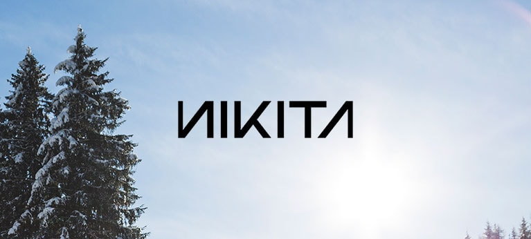 Nikita logo with blue skies and wintry trees