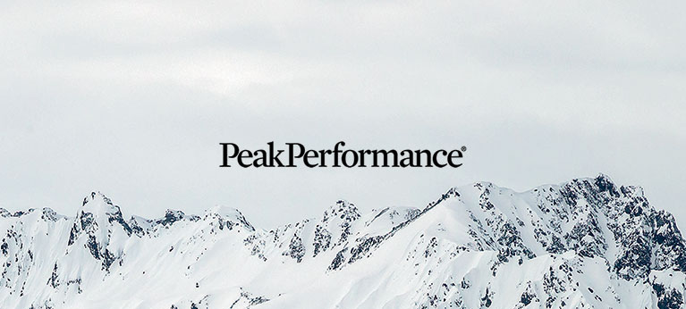 Peak Performance logo with snowy mountain tops in background