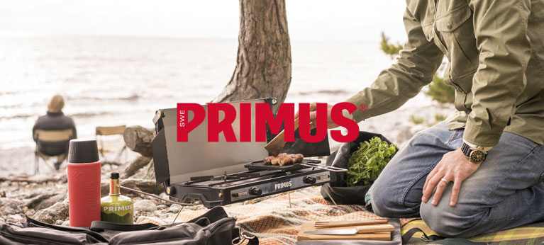 Primus logo with a lake scene behind