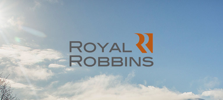 Royal Robbins logo with blue sky and small cloud in the background