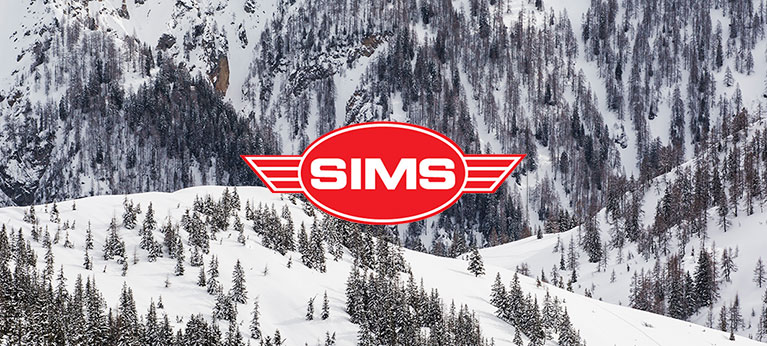 Sims logo with snowy forest in background