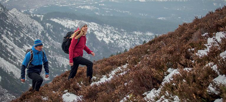 male and female hiking