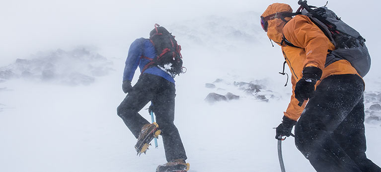 winter mountaineers ascending mountain