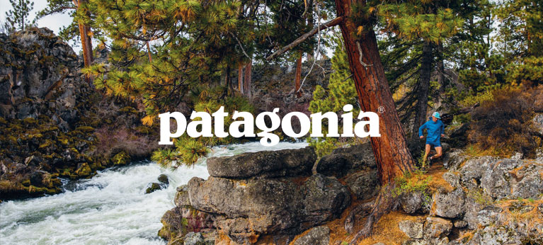 A man trail running in Patagonia clothing