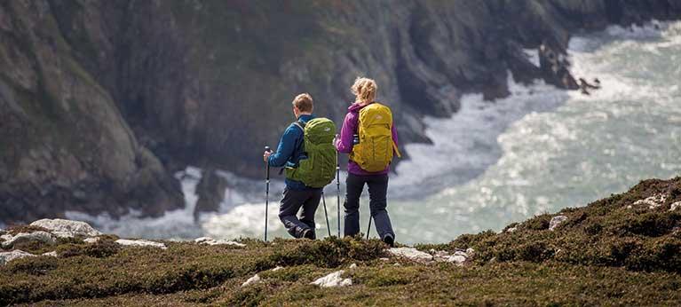 couple backpacking at coastal area