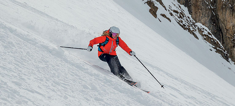 Woman skiing down mountainside