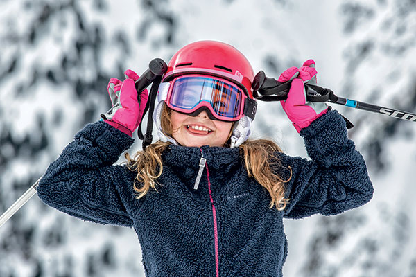 young girl with ski mid layer on