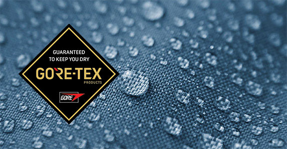 blue fabric with water droplets on and Gore-Tex logo