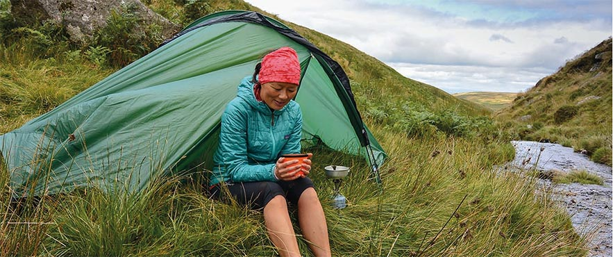 a woman wild camping