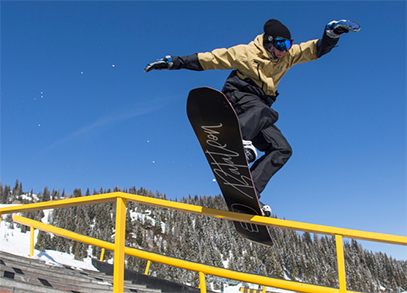 A snowboarder grinding a rail