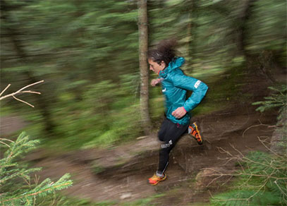 A woman trail running at a fast speed