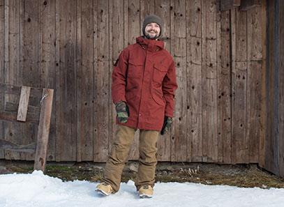 A man in a snowboard jacket and pants