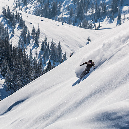 Man snowboarding in the Backcountry