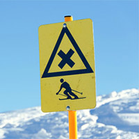 a cross trail sign